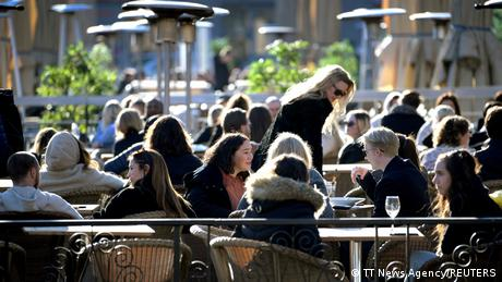 People enjoy the sun at an outdoor restaurant despite the continuing spread of coronavirus disease (COVID-19) in Stockholm, Sweden