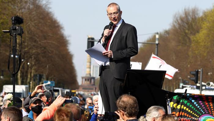 Hansjörg Müller from party Alternative fur Deutschland (AfD) delivers a speech during a protest against the government measures to curb the spread of the coronavirus disease