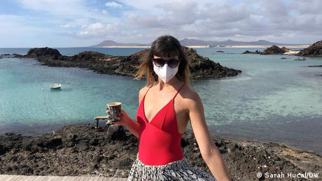 The author, Sarah Hucal, wears a face mask during a day trip to Isla del Lobos off the coast of Corralejo, Fuerteventura