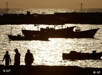 Palestinians walk at the Gaza City port