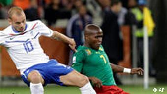 Netherlands' Wesley Sneijder, left, and Cameroon's Landry Nguemo vie for the ball during the World Cup group E soccer match between Cameroon and the Netherlands in Cape Town, South Africa, Thursday, June 24, 2010. (AP Photo/Schalk van Zuydam)