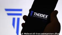 In this illustration photo global cryptocurrency exchange Thodex logos are both displayed on a smart phone and a pc screen in Ankara, Turkey on April 22, 2021.