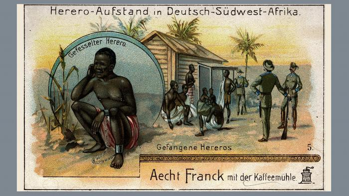 Contemporary picture from 1904 showing a man in chains and other Herero prisoners and German soldiers