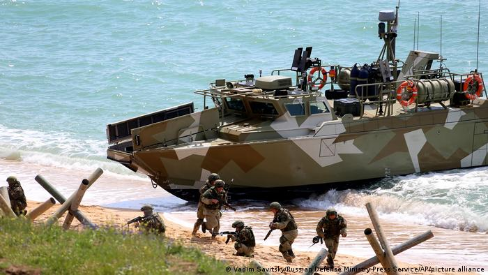 Russian soldiers taking part in military drills after disembarking from a boat in Crimea