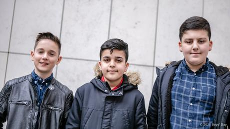 Three young boys looking into the camera
