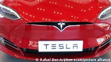 AUCKLAND - AUG 12 2018:The insignia of Tesla on the front bonnet of the plug-in electric car Model S. The company's Model S was the world's best-selling plug-in electric car in 2015 and 2016 Photo via Newscom picture alliance