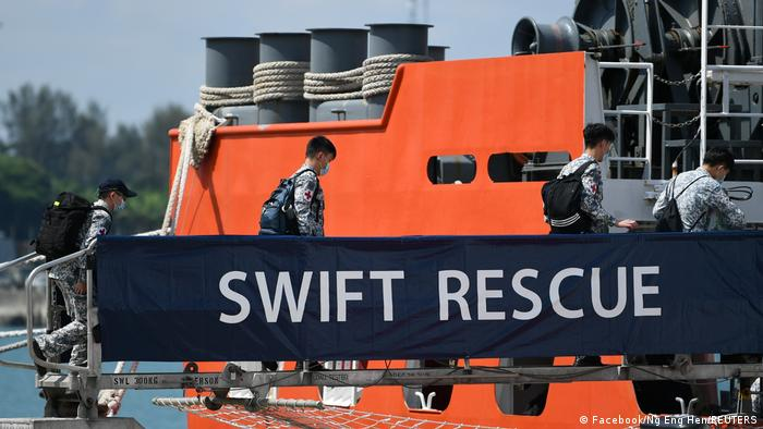 Officers board Singapore Navy's MV Swift Rescue ahead of rescue efforts for Indonesia's missing submarine KRI Nanggala-402