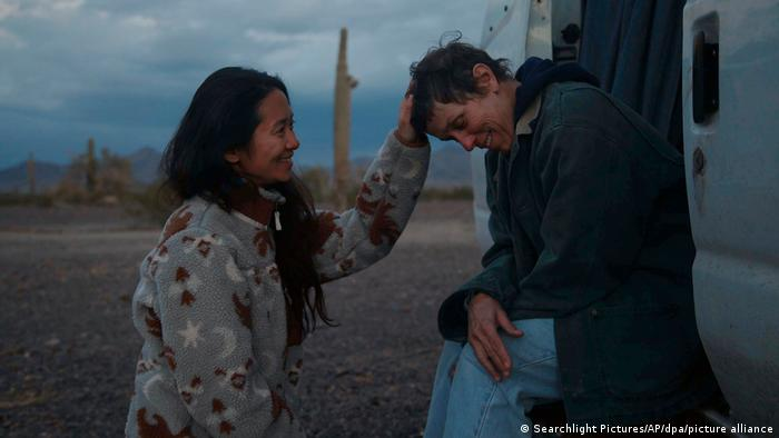 Filming Nomadland, director Chloe Zhao with actress Frances McDormand on set