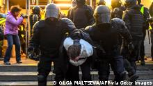 TOPSHOT - Police officers detain a protester during a rally in support of jailed Kremlin critic Alexei Navalny, in central Saint-Petersburg on April 21, 2021. - Jailed Kremlin critic Alexei Navalny's team called for demonstrations in more than 100 cities, after the opposition figure's doctors said his health was failing following three weeks on hunger strike. (Photo by Olga MALTSEVA / AFP) (Photo by OLGA MALTSEVA/AFP via Getty Images)