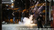 JERUSALEM - APRIL 23: Israeli forces intervene Palestinian Muslims, who gathered in Damascus Gate after performing Tarawih prayer in Al-Aqsa Compound, with water cannon vehicles and sound bombs to now allow for gathering at Old Town district in Eastern Jerusalem on April 23, 2021. 105 Palestinians injured during Israeli interventions. Mostafa Alkharouf / Anadolu Agency