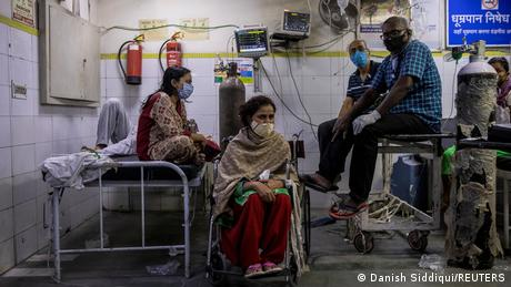 Patients suffering from COVID-19 get treatment at the casualty ward in Lok Nayak Jai Prakash (LNJP) hospital