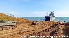 This handout photo taken from a video released on Friday, April 23, 2021 by Russian Defense Ministry Press Service shows, Russian military's armored vehicles roll into landing vessels after drills in Crimea. Russian Defense Minister Sergei Shoigu on Thursday ordered troops back to their permanent bases after a massive military buildup that caused Ukrainian and Western concerns. (Russian Defense Ministry Press Service via AP)