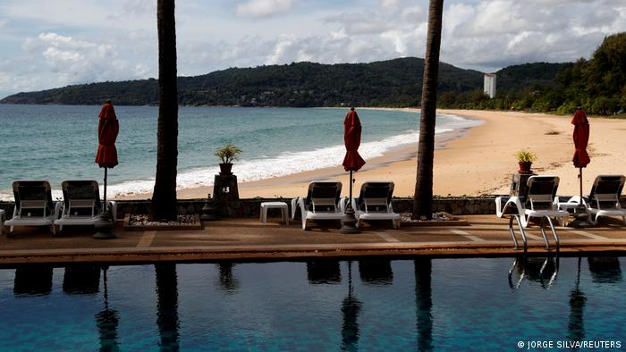 An empty hotel and beach which have opened for visitors is seen in Karon, Phuket Island, Thailand