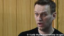Kremlin critic Alexei Navalny, who was arrested during March 26 anti-corruption rally, attends a hearing at a court in Moscow on March 27, 2017. - Russian opposition leader Alexei Navalny was sentenced to 15 days behind bars and fined Monday after he and more than 1,000 other demonstrators were detained at an anti-corruption protest in Moscow that was branded a provocation by the Kremlin. (Photo by Vasily MAXIMOV / AFP) (Photo by VASILY MAXIMOV/AFP via Getty Images)