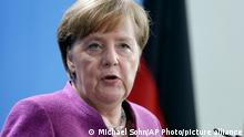 FILE - In this March 16, 2018*** file photo. German Chancellor Angela Merkel, speaks during a joint press conference after a meeting with the Prime Minister of Sweden, Stefan Loefven, in Berlin. German Chancellor Angela Merkel's defending the country's trade surplus in her weekly video podcast Saturday, March 17, 2018, saying the government's working to encourage domestic demand but that not all factors are in its control. (AP Photo/Michael Sohn,file)
