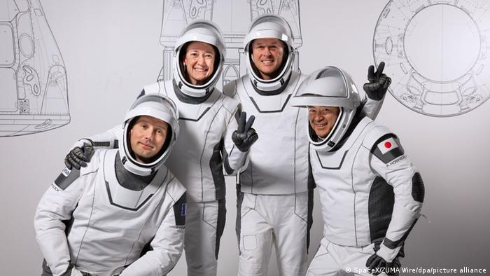 Four astranauts pose for a press photo before flying to the International Space Station