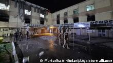 BAGHDAD, IRAQ - APRIL 24: A view of Ibn al-Hatip Hospital as fire erupts at the hospital where coronavirus patients were being treated in Baghdad, Iraq on April 24, 2021. Nearly 20 people died in a fire at a hospital where coronavirus patients were being treated in Baghdad, according to sources on Saturday. Murtadha Al-Sudani / Anadolu Agency