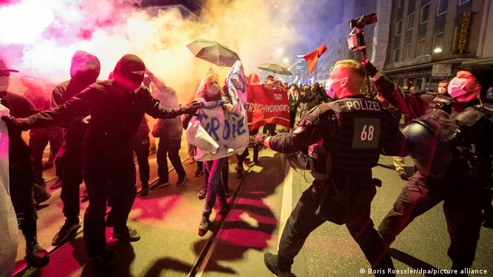 Protesters wearing masks face off with police in Frankfurt's city center