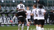 MOENCHENGLADBACH, GERMANY - APRIL 25: Breel Embolo of Borussia Moenchengladbach celebrates with team mates after scoring their side's first goal during the Bundesliga match between Borussia Moenchengladbach and DSC Arminia Bielefeld at Borussia-Park on April 25, 2021 in Moenchengladbach, Germany. Sporting stadiums around Germany remain under strict restrictions due to the Coronavirus Pandemic as Government social distancing laws prohibit fans inside venues resulting in games being played behind closed doors. (Photo by Lars Baron/Getty Images)