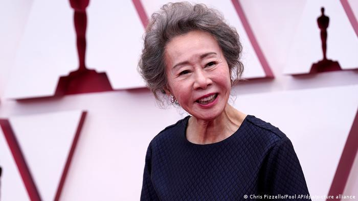 A portrait of Yuh-Jung Youn at the opening of the 93rd Academy Awards ceremony.