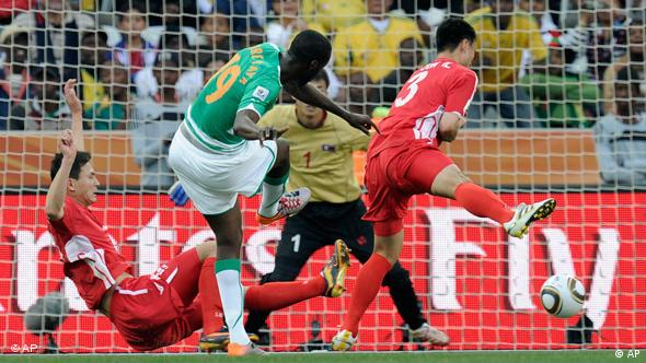 Ivory Coast's Yaya Toure, center, scores the opening goal against North Korea.