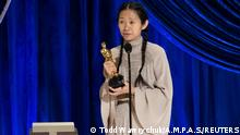 Chloe Zhao accepts the Oscar for Directing during the live ABC Telecast of The 93rd Oscars in Los Angeles, California, U.S., April 25, 2021. Todd Wawrychuk/A.M.P.A.S./Handout via REUTERS ATTENTION EDITORS. THIS IMAGE HAS BEEN SUPPLIED BY A THIRD PARTY. NO MARKETING OR ADVERTISING IS PERMITTED WITHOUT THE PRIOR CONSENT OF A.M.P.A.S AND MUST BE DISTRIBUTED AS SUCH. MANDATORY CREDIT. NO RESALES. NO ARCHIVES