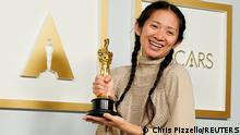 Director/Producer Chloe Zhao, winner of the award for best picture for Nomadland, poses in the press room at the Oscars in Los Angeles, California, U.S., April 25, 2021. Chris Pizzello/Pool via REUTERS