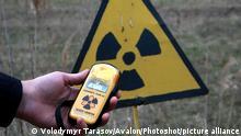 21.04.2021 KYIV REGION, UKRAINE - APRIL 21, 2021 - A person holds a radiation dosimeter near the Red Forest, Kyiv Region, northern Ukraine., Credit:Volodymyr Tarasov / Avalon