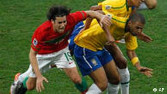 Portugal's Tiago (left) and Brazilian Gilberto Silva tussle for possession.