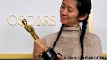 Chloe Zhao poses in the press room at the Oscars in Los Angeles, California, April 25