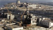 Photo, dated 01 October 1986, showing repairs being carried out on the Chernobyl nuclear plant in the Ukraine, following a major explosion 26 April 1996 which, according to official statistics, affected 3,235,984 Ukrainians and sent radioactive clouds all over Europe. (Photo credit should read ZUFAROV/AFP via Getty Images)