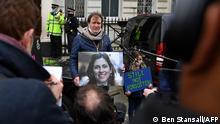March 8, 2021*** Richard Ratcliffe, husband of British-Iranian aid worker Nazanin Zaghari-Ratcliffe jailed in Tehran since 2016, and his daughter Gabriella, attend a protest outside of the Iranian Embassy in London on March 8, 2021. - The UK government on Sunday called for the immediate release of a British-Iranian woman after her five-year sentence for sedition ended in Iran, as a new court summons caused further uncertainty about her fate. (Photo by Ben STANSALL / AFP)