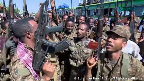 Ethiopian soldiers cheering and dancing