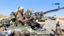 This image made from undated video released by the state-owned Ethiopian News Agency on Monday, Nov. 16, 2020 shows Ethiopian military in an armored personnel carrier, on a road in an area near the border of the Tigray and Amhara regions of Ethiopia. Ethiopia's prime minister Abiy Ahmed said in a social media post on Tuesday, Nov. 17, 2020 that the final and crucial military operation will launch in the coming days against the government of the country's rebellious northern Tigray region. (Ethiopian News Agency via AP)