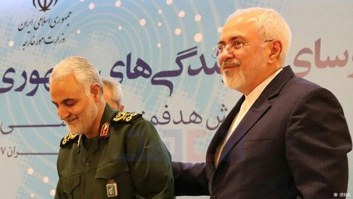 Mohammad Javad Zarif with his hand on Qassem Soleimani's back