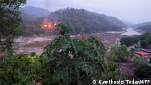 27.04.2021 This handout from Kawthoolei Today taken and released on April 27, 2021 shows fires burning at a Myanmar military base along the bank of the Salween river, as seen from Mae Sam Laep town in Thailand's Mae Hong Son province, after the base was attacked and captured by the Karen National Union (KNU) as the country remains in turmoil after the February 1 military coup. (Photo by Handout / KAWTHOOLEI TODAY / AFP) / -----EDITORS NOTE --- RESTRICTED TO EDITORIAL USE - MANDATORY CREDIT AFP PHOTO / KAWTHOOLEI TODAY - NO MARKETING - NO ADVERTISING CAMPAIGNS - DISTRIBUTED AS A SERVICE TO CLIENTS