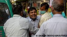 Delhi: Ein Mann trauert um den Tod eines Angehörigen