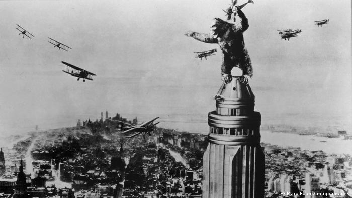 Still from the film King Kong with the gorilla on top of the Empire State Building.