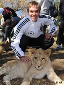 Philipp Lahm and a baby Lion