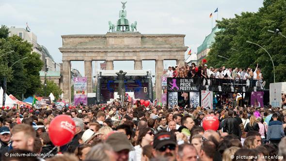 People at a parade near Berlin's Brandenburg Gate
