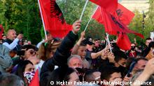Supporters of Albania's Prime Minister Edi Rama wave flags of their country during a rally in Tirana, Albania, Tuesday, April 27, 2021. Albania's left-wing Socialist Party has secured a third consecutive mandate in a parliamentary election, winning a majority of seats in parliament, Prime Minister Edi Rama said on Tuesday. (AP Photo/Hektor Pustina)