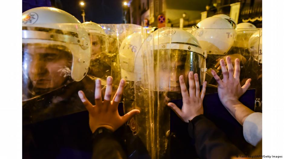 Demonstrators in Istanbul putting hands on shields of riot police. Photo: Yasin Akgul, Turkey