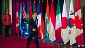 Werden jetzt Merkel und Sarkozy die Finanzmarkt-Transaktionssteuer in Europa durchboxen? (Foto:AP)