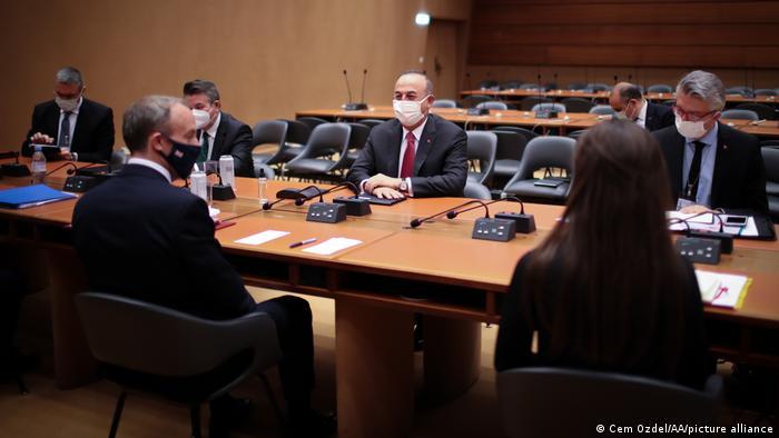 Turkish Foreign Minister, Mevlut Cavusoglu (2nd R) and British Foreign Secretary Dominic Raab (L) meet