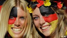 Supporters of the German team pose for photos before the World Cup round of 16 soccer match between Germany and England at Free State Stadium in Bloemfontein, South Africa, Sunday, June 27, 2010. (AP Photo/Kirsty Wigglesworth)