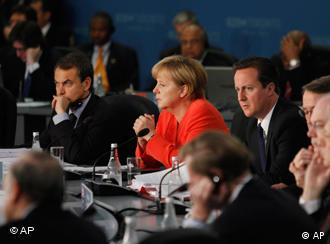 Britain's Prime Minister David Cameron, center right, Germany's Chancellor Angela Merkel, center, and Spain's Prime Minister Jose Luis Rodriquez Zapatero, left