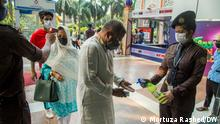 Bangladesh's COVID vaccination efforts have been hit hard after India halted coronavirus vaccine shipments. India has paused exports during a surge in new infections and a rising death toll. --- Place: Dhaka Date: April 26 to 28