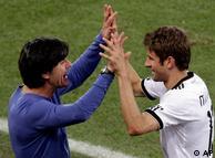Germany head coach Joachim Loew, left, congratulates Germany's Thomas Mueller