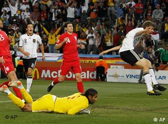 Germany's Thomas Mueller scores against England