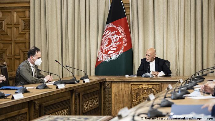 Two men at a desk for talks